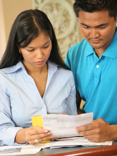 Asian American Couple Paperwork79078142